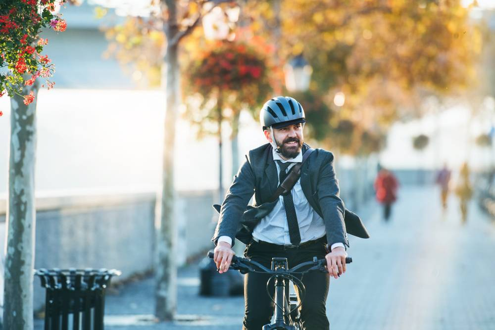 Man cycling to work helmet suit