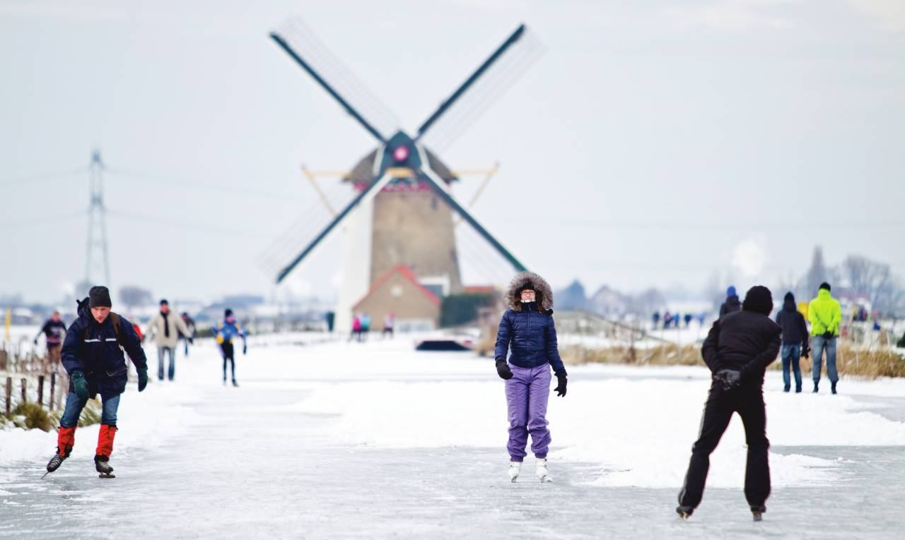 Ice skaters the Netherlands windmill