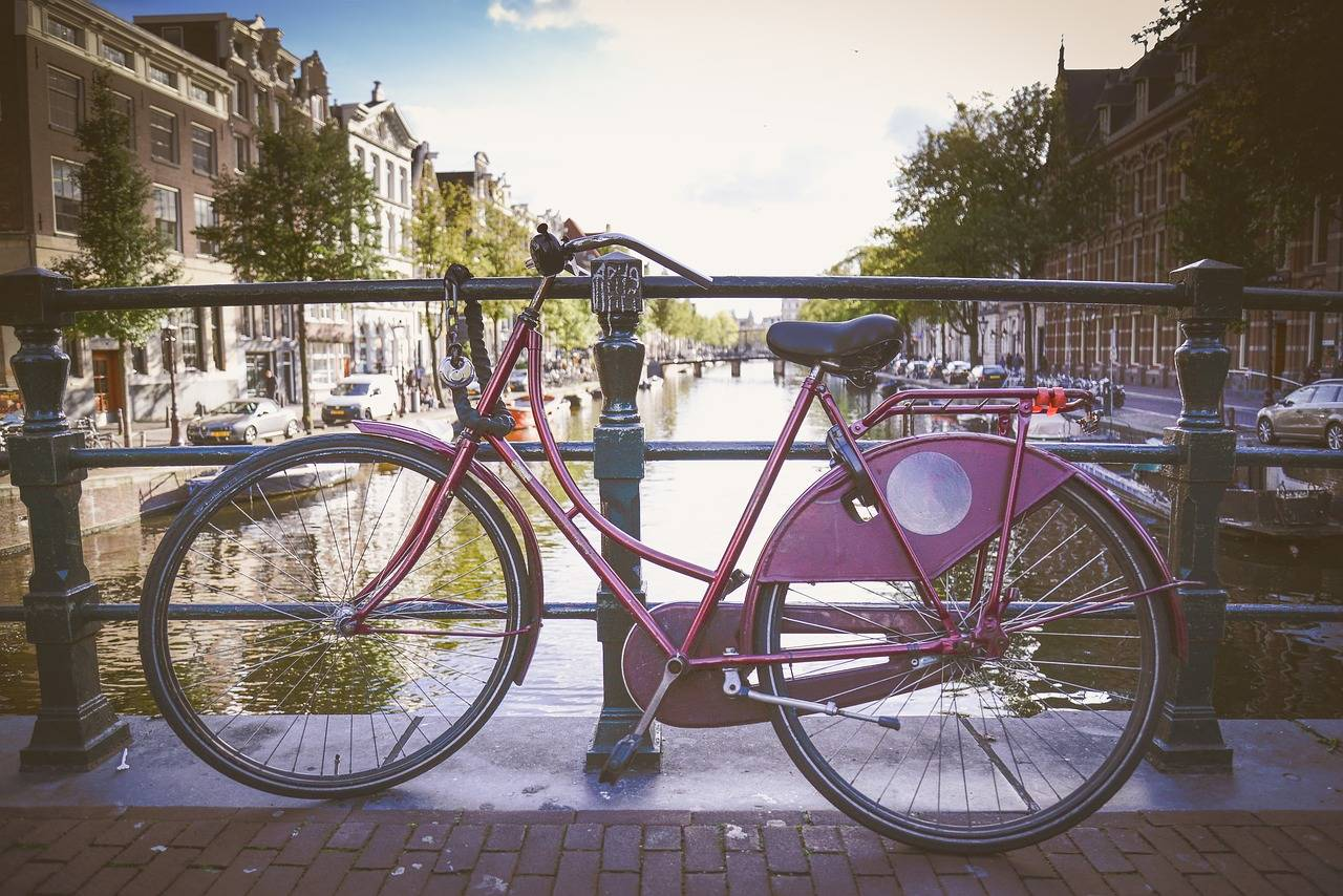 Purple Oma Fiets in Amsterdam on bridge